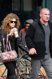 AnnaLynne McCord added an unexpectedly girly touch to her slick street style with a feminine cloth tote.