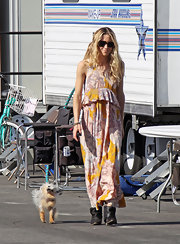 Gillian dons a 70's inspired floral print maxi dress on the set of 90210.