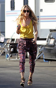 Gillian dons wild silk harem pants with a wild 70's paisley print on the set of 90210.