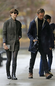 Anne Hathaway opted for a classic tweed coat for her rainy day look while out in NYC.