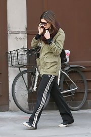Anne Hathaway braved the cold in an olive cargo coat and Adidas track jackets.