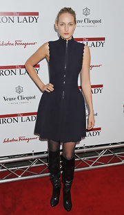 Leelee Sobieski added a bondage vibe to her scallop-trimmed dress with slouchy black knee high boots.