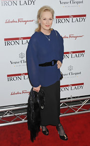 Meryl Streep kept covered up at the premiere of 'The Iron Lady' in a sheer blue blouse.