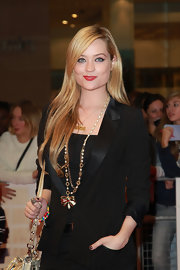 Laura Whitmore arrived at the European premiere of 'One Day' with a look that said glamorous, with an edge. Her strong cat-eye liner held its own against her bold red lips.