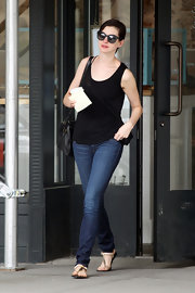Anne Hathaway chose a classic black tank for her casual and simple look while out in NYC.