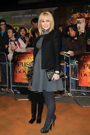Amanda Holden carried an embossed leather clutch to the U.K. premiere of 'Puss in Boots.'