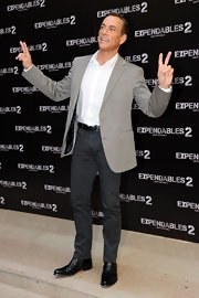 Jean-Claude Van Damme paired gray skinny pants with a taupe blazer for the 'Expendables 2' photocall.