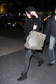 "Ashlee's houndstooth ""Pied De Poule"" woven leather tote bag can carry all of her new mommy needs."