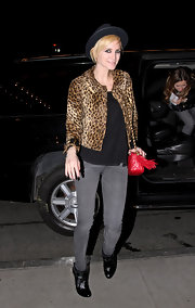 Showing off the growing leopard trend. Ashlee paired her distressed jeans with a leopard print jacket.