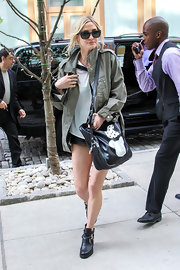 Ashlee Simpson stuck to her punk roots when she sported this army green utility jacket on the streets of NYC.