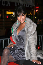 Vivica A. Fox looked glamorous in this classic beehive updo with front bangs.