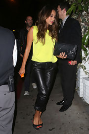 Shay Mitchell paired her neon yellow billowing blouse with skinny leather pants for a bold pop of color.