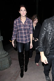 Ashley Greene donned dramatic Casadei boots with liquid leather pants and a plaid shirt. The patent and suede over-the-knee boots boast a statuesque carved heel.