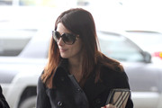 Ashley Greene, carrying her dog in a doggie duffel bag and an iPad, arrives at LAX Airport to catch a departing flight out of Los Angeles. Ashley is reportedly headed out of town to film the final installment in