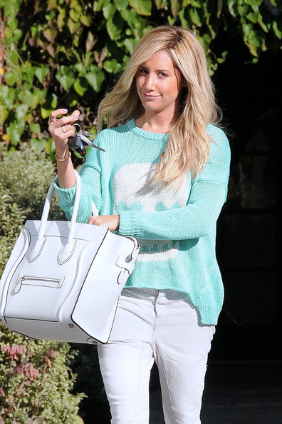 Ashley Tisdale Looks Through Her Bag