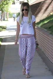 Ashley's 'Trouble' tee looked comfy and cozy when paired with her printed harem pants.