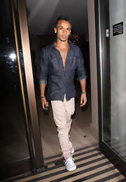 Singer Aston Merrygold struts his stuff in a chambray button-down shirt with pushed up cuffs.