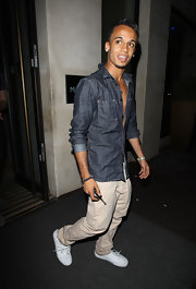 Aston kept it cool with this denim button down shirt.