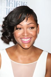 Meagan Good used a cool glossy pink lip color to complete her look for an evening out in Las Vegas.