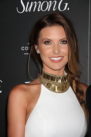Audrina opted for a long side braid for her sleek and sexy red carpet look.