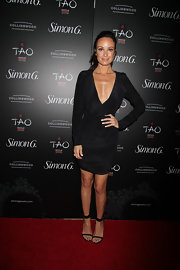 Catt Sadler chose a long-sleeve black dress with a deep V-neck for her red carpet look.