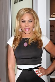 Adrienne Maloof sweetened up her look with a glittery pink pendant necklace during the Magic Fashion and Apparel Trade Show.