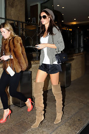 Super model Nicole Trufio paired her over-the-knee boots with a quilted leather handbag.