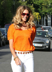 Elle MacPherson maintained her supermodel looks while taking her kids to school. The beauty styled her hair in long center part curls that were softly parted down the center.