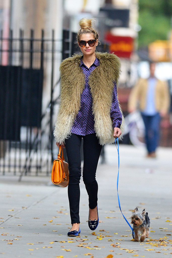 Australian model Jessica Hart sports a furry vest and polka dot shirt while taking her dog for a walk in New York City.