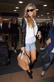 Delta Goodrem dressed up her denim cutoffs with a chic black-and-white cropped jacket.