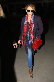 Kylie Minogue added an unexpected dash of to her look with this print scarf.
