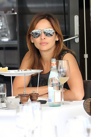 Natalie Imbruglia tried to hide her pretty face with a pair of aviators while having lunch in Sydney.