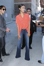 "Zoe visited the 'Jimmy Kimme Show' wearing a pair of ""Babe"" Low-Rise Super Bell Bottom jeans."
