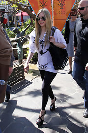 Apart from her towering heels, Avril Lavigne kept her look low-key in an anchor hoodie and black leggings.