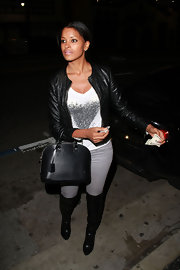 Claudia Jordan stepped out in trendy black leather over the knee boots.