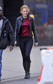 Blake Lively was spotted on the set of 'Gossip Girl' in a rocker-chic leather jacket paired with black leather knee-high boots complete with buckled detailing.