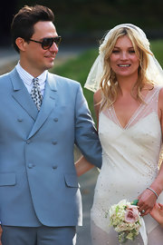 Kate Moss was glowing on her wedding day. She styled her tresses in soft tousled curls.
