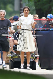 Katie's white and black floral skirt added a touch of romance to her retro-inspired costume on set.