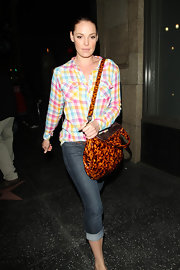 Katherine made her way out of Katsuya restaurant wearing a casual plaid shirt and cuffed jeans. She carried an eye-cathing cross-body bag, which really didn't go with the rest of her outfit.