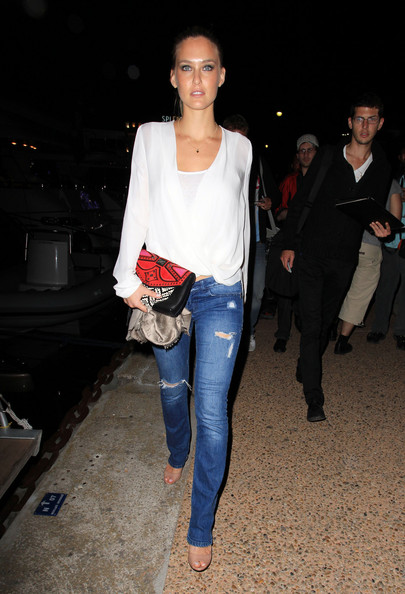 Bar Refaeli added pop to her simple look with a detailed red and black leather clutch.