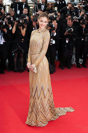 Barbara Palvin wore a stunning metallic floor-length number with rope details at the 'Lawless' premiere.