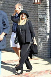 Barbra Streisand was dressed for comfort in a casual all-black outfit and wedges during a party in Malibu.