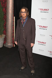 Johnny Depp showed off his signature style in a brown pin striped suit.