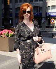 Christina Hendricks arrived for an appearance on 'Live! With Kelly' wearing her vibrantly tinted tresses in layered curls.