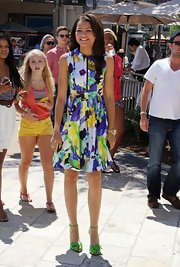 Zendaya wore a chunky gold menswear inspired watch with her colorful dress.