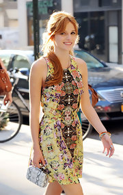 Bella got playful with patterns and paired her printed sundress with a snakeskin clutch for on-trend elegance.