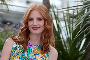 Jessica Chastain was lovely at the Cannes Film Festival in a brightly colored day dress and wearing her hair in soft waves.