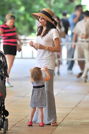 Bethenny Frankel maintained the ease of her summery look with a white tunic length T-shirt and floor-grazing maxi skirt.