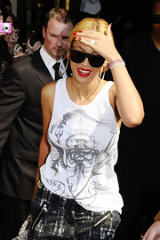Beyonce paired her bold red lips with vibrant crimson nails while in Paris.