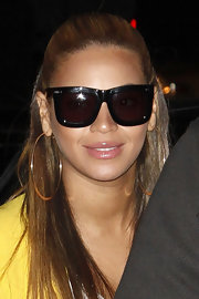 Beyonce Knowles shielded her gaze in a pair of black rectangular sunglasses with thick frames.